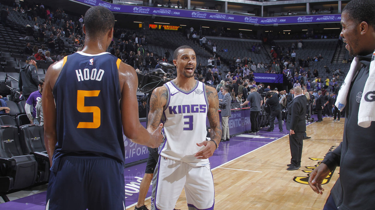 SACRAMENTO, CA - JANUARY 17: George Hill #3 of the Sacramento Kings greets Rodney Hood #5 of the Utah Jazz after the game on January 17, 2018 at Golden 1 Center in Sacramento, California. NOTE TO USER: User expressly acknowledges and agrees that, by downloading and or using this photograph, User is consenting to the terms and conditions of the Getty Images Agreement. Mandatory Copyright Notice: Copyright 2018 NBAE