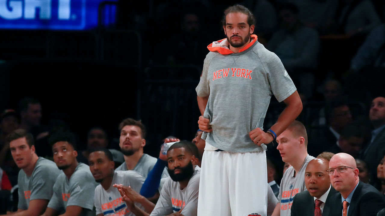 NEW YORK, NY - OCTOBER 15: Joakim Noah #13 of the New York Knicks looks on from the bench against the Boston Celtics during the second half of their preseason game at Madison Square Garden on October 15, 2016 in New York City.