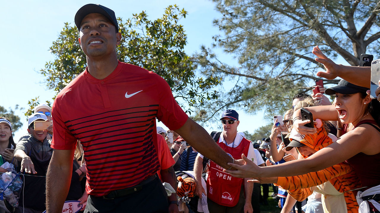 SAN DIEGO, CA - JANUARY 28: Tiger Woods high fives a fan during the final round of the Farmers Insurance Open at Torrey Pines South on January 28, 2018 in San Diego, California.