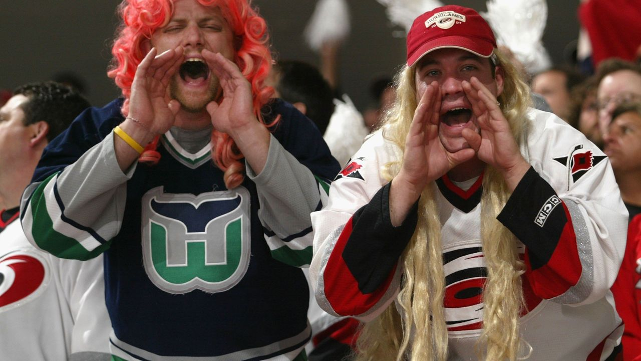 RALEIGH, NC - JUNE 14: Fans of the Carolina Hurricanes cheer during game five of the 2006 NHL Stanley Cup Finals against the Edmonton Oilers on June 14, 2006 at the RBC Center in Raleigh, North Carolina.