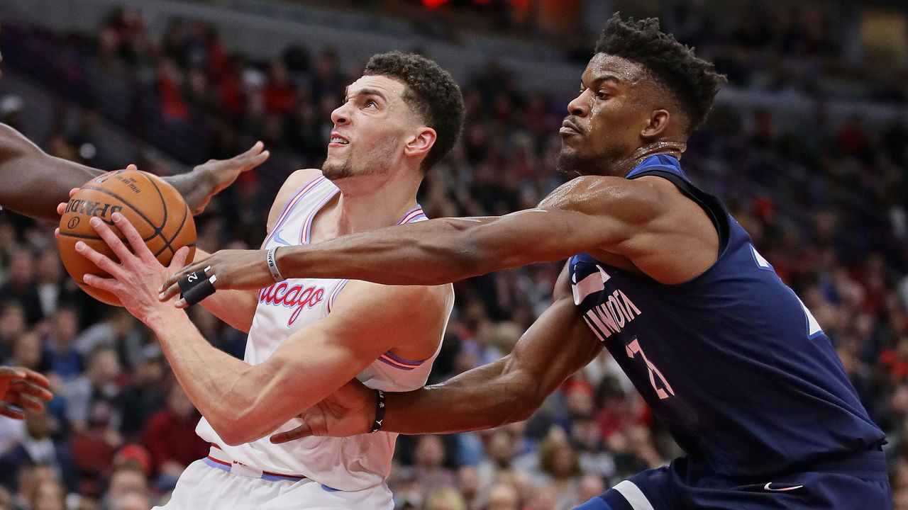 CHICAGO, IL - FEBRUARY 09: Zach LaVine #8 of the Chicago Bulls drives past Jimmy Butler #23 of the Minnesota Timberwolves at the United Center on February 9, 2018 in Chicago, Illinois.
