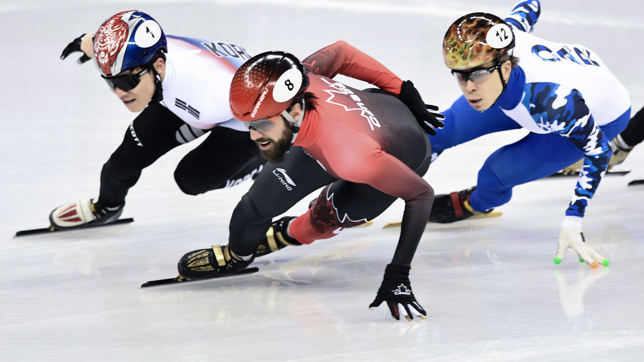 South Korea's Seo Yira (L), Canada's Charles Hamelin (C) and Russia's Semen Elistratov take part in the men's 1,500m short track speed skating semi-final event during the Pyeongchang 2018 Winter Olympic Games, at the Gangneung Ice Arena in Gangneung on February 10, 2018. / AFP PHOTO / ARIS MESSINIS
