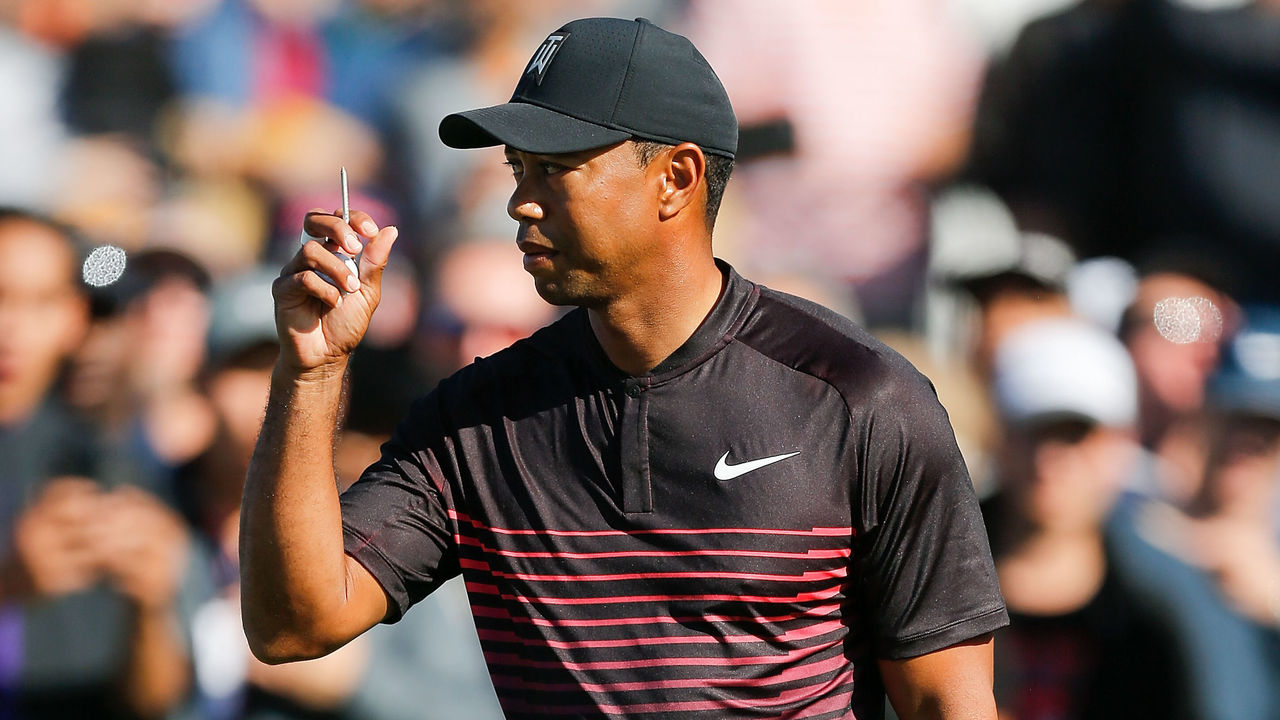 SAN DIEGO, CA - JANUARY 25: Tiger Woods motions to the crowd before plays his shot from the first tee during the first round of the Farmers Insurance Open at Torrey Pines on January 25, 2018 in San Diego, California.