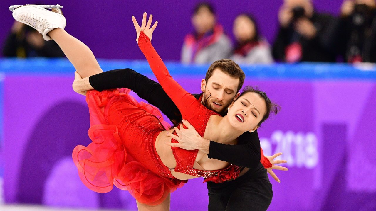 South Korea's Yura Min and South Korea's Alexander Gamelin compete in the figure skating team event ice dance short dance during the Pyeongchang 2018 Winter Olympic Games at the Gangneung Ice Arena in Gangneung on February 11, 2018. / AFP PHOTO / Mladen ANTONOV