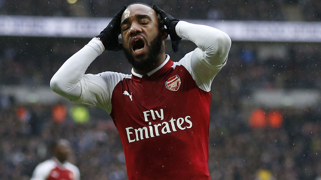 Arsenal's French striker Alexandre Lacazette reacts after missing a chance during the English Premier League football match between Tottenham Hotspur and Arsenal at Wembley Stadium in London, on February 10, 2018. / AFP PHOTO / IKIMAGES / Ian KINGTON / RESTRICTED TO EDITORIAL USE. No use with unauthorized audio, video, data, fixture lists, club/league logos or 'live' services. Online in-match use limited to 45 images, no video emulation. No use in betting, games or single club/league/player publications. /