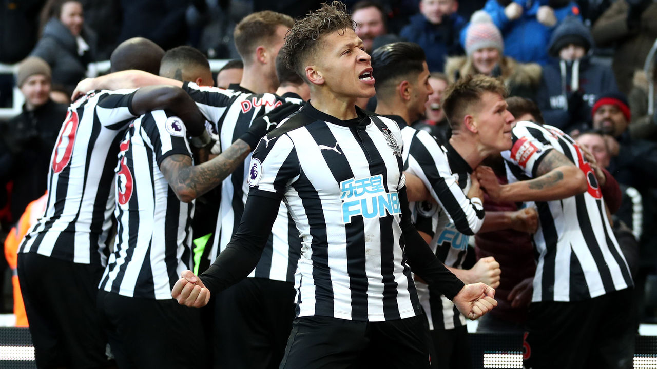 NEWCASTLE UPON TYNE, ENGLAND - FEBRUARY 11: Dwight Gayle of Newcastle United celebrates his sides first goal during the Premier League match between Newcastle United and Manchester United at St. James Park on February 11, 2018 in Newcastle upon Tyne, England.