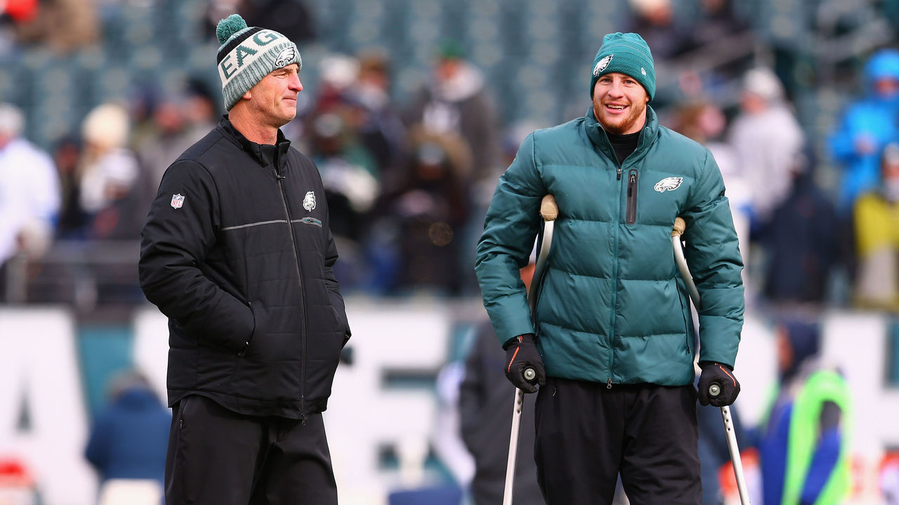 PHILADELPHIA, PA - DECEMBER 31: Injured quarterback Carson Wentz #11 (R) talks with Offensive Coordinator Frank Reich (L) before the game against the Dallas Cowboys at Lincoln Financial Field on December 31, 2017 in Philadelphia, Pennsylvania.