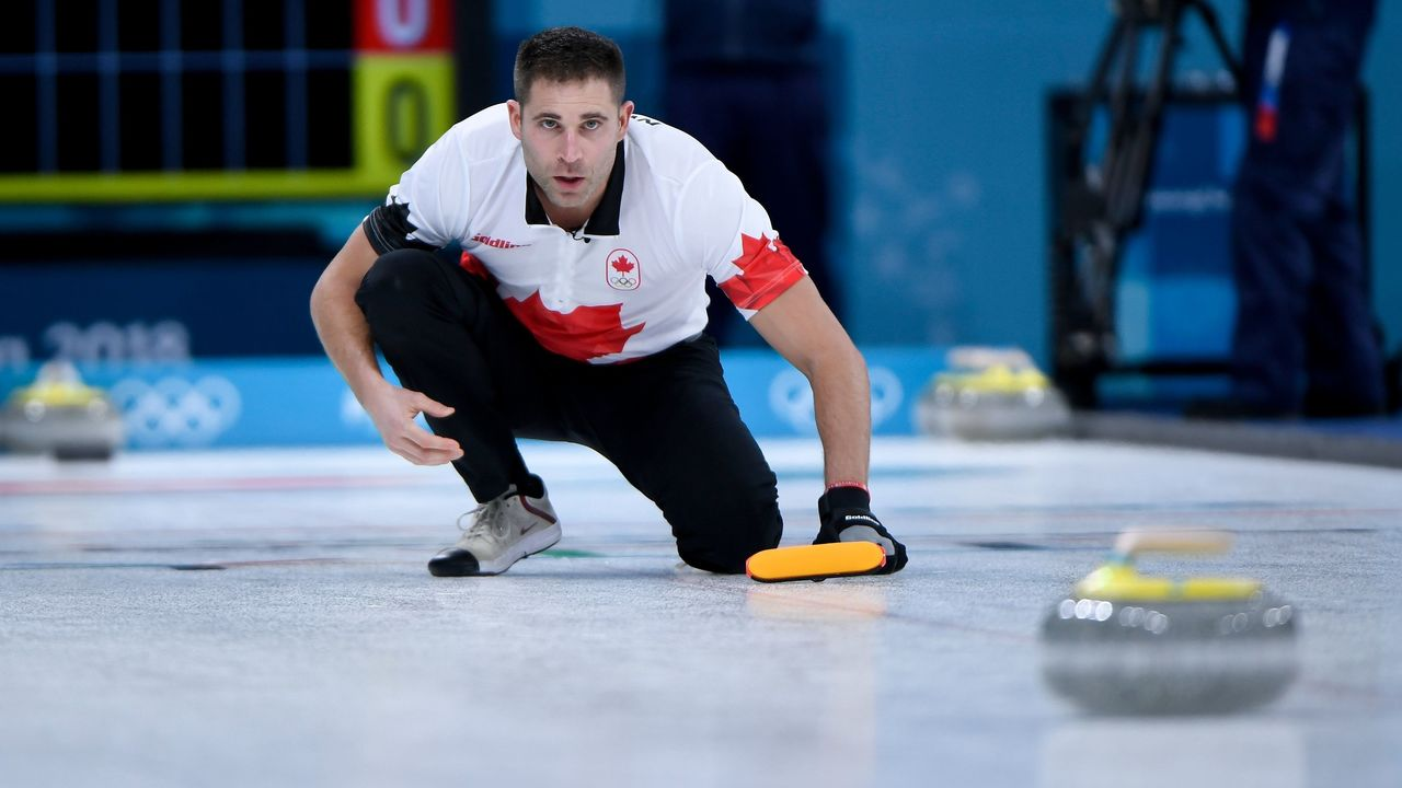 Canada's John Morris watches the stone during the curling mixed doubles round robin session between the US and Canada during the Pyeongchang 2018 Winter Olympic Games at the Gangneung Curling Centre in Gangneung on February 8, 2018. / AFP PHOTO / WANG Zhao