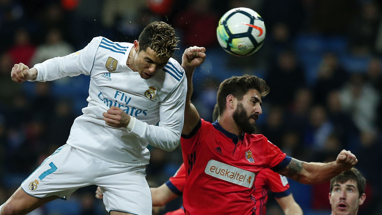 MADRID, SPAIN - FEBRUARY 10: Cristiano Ronaldo of Real Madrid CF wins the header after Raul Navas of Real Sociedad de Futbol during the La Liga match between Real Madrid CF and Real Sociedad de Futbol at Estadio Santiago Bernabeu on February 10, 2018 in Madrid, Spain.