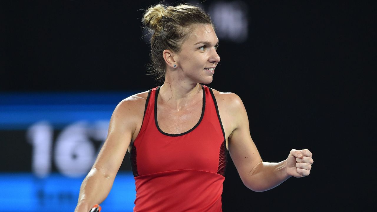 Romania's Simona Halep reacts against Denmark's Caroline Wozniacki during their women's singles final match on day 13 of the Australian Open tennis tournament in Melbourne on January 27, 2018. / AFP PHOTO / PETER PARKS / -- IMAGE RESTRICTED TO EDITORIAL USE - STRICTLY NO COMMERCIAL USE --