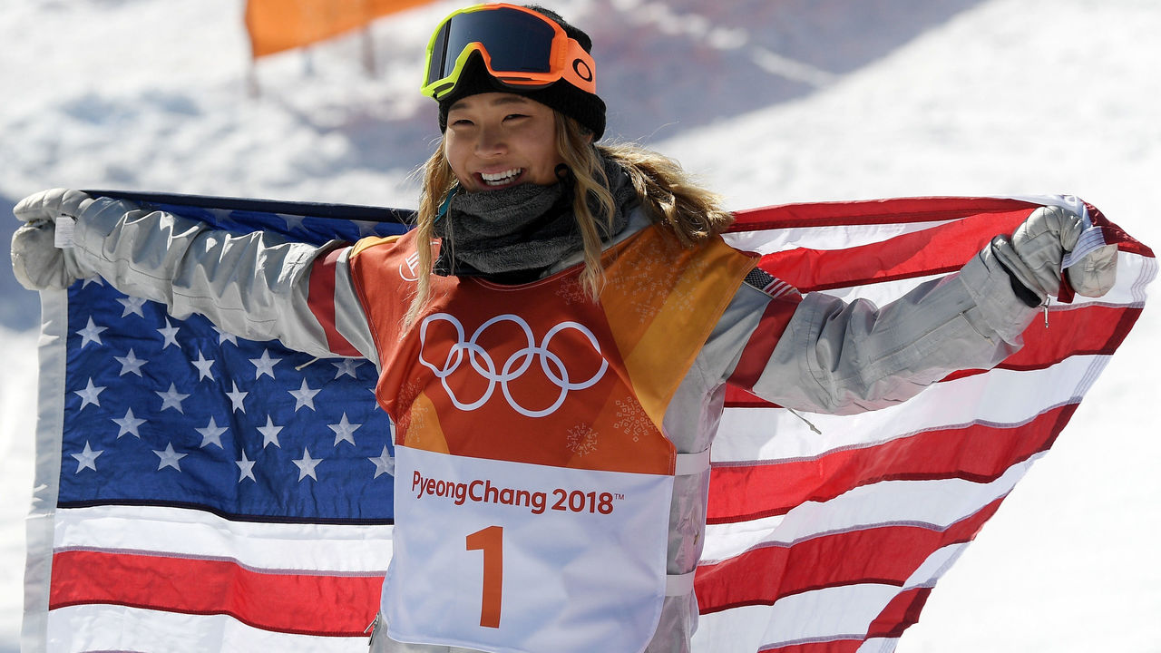 PYEONGCHANG-GUN, SOUTH KOREA - FEBRUARY 13: Gold medalist Chloe Kim of the United States celebrates winning the Snowboard Ladies' Halfpipe Final on day four of the PyeongChang 2018 Winter Olympic Games at Phoenix Snow Park on February 13, 2018 in Pyeongchang-gun, South Korea.