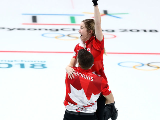 GANGNEUNG, SOUTH KOREA - FEBRUARY 13: John Morris and Kaitlyn Lawes of Canada celebrate defeating Switzerland to win the gold medal during the Curling Mixed Doubles Gold Medal Game on day four of the PyeongChang 2018 Winter Olympic Games at Gangneung Curling Centre on February 13, 2018 in Gangneung, South Korea.