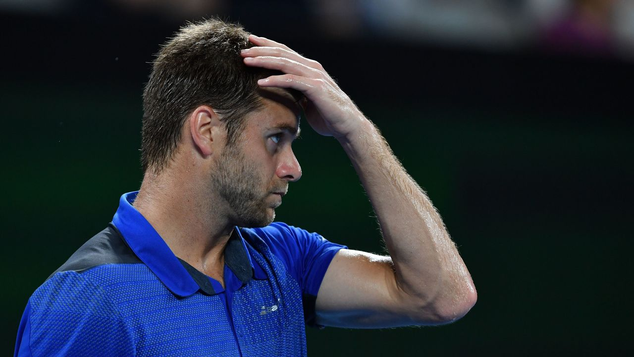 Ryan Harrison of the US gestures after a point against Croatia's Marin Cilic during their men's singles third round match on day five of the Australian Open tennis tournament in Melbourne on January 19, 2018. / AFP PHOTO / Paul Crock / -- IMAGE RESTRICTED TO EDITORIAL USE - STRICTLY NO COMMERCIAL USE --