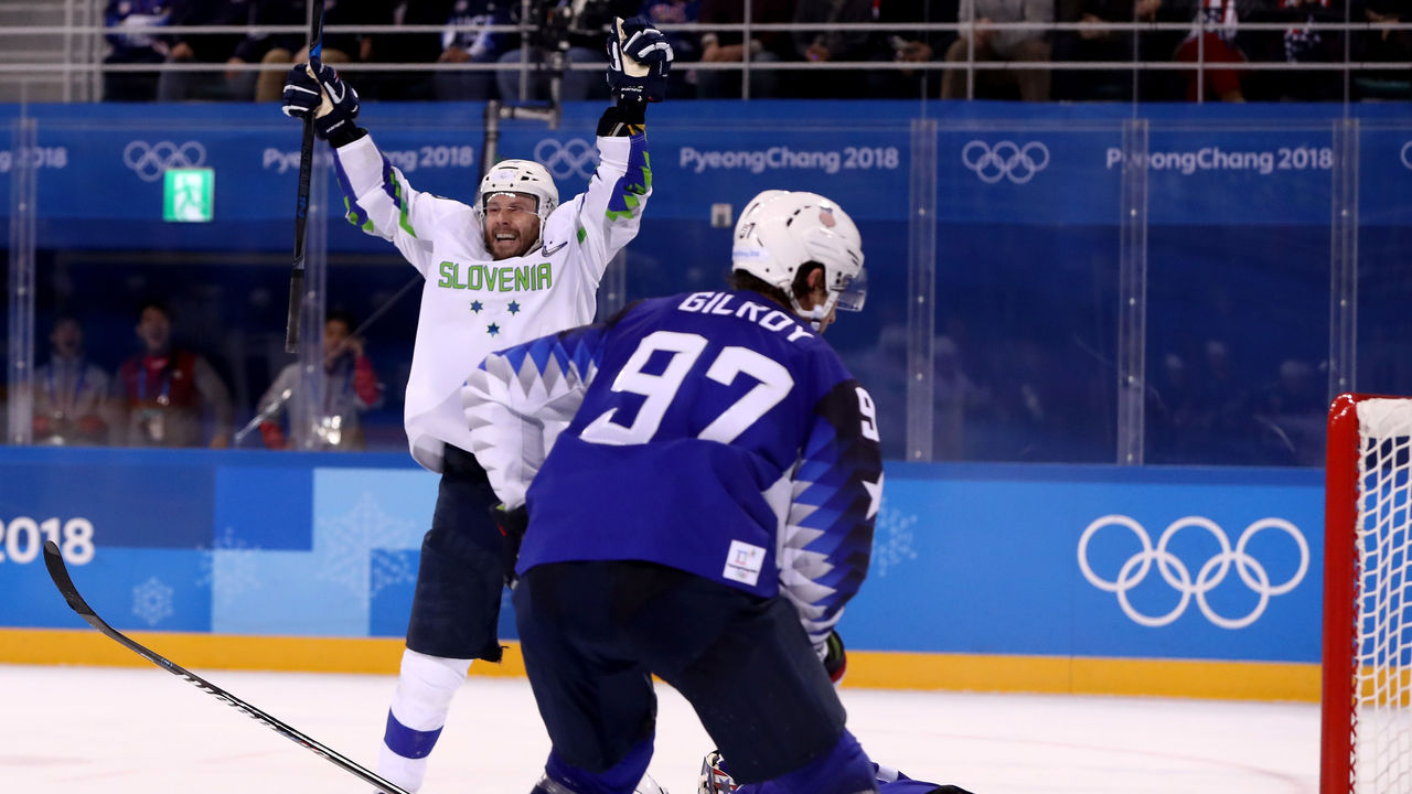 GANGNEUNG, SOUTH KOREA - FEBRUARY 14: Jan Mursak #39 of Slovenia celebrates after scoring the game winning goal against Ryan Zapolski #30 of the United States in overtime of the Men's Ice Hockey Preliminary Round Group B game on day five of the PyeongChang 2018 Winter Olympics at Kwandong Hockey Centre on February 14, 2018 in Gangneung, South Korea.