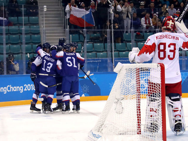 GANGNEUNG, SOUTH KOREA - FEBRUARY 14: Peter Olvecky #85 of Slovakia celebrates with teammates after scoring a goal in the first period against Vasili Koshechkin #83 of Olympic Athletes from Russia during the Men's Ice Hockey Preliminary Round Group B game on day five of the PyeongChang 2018 Winter Olympics at Gangneung Hockey Centre on February 14, 2018 in Gangneung, South Korea.