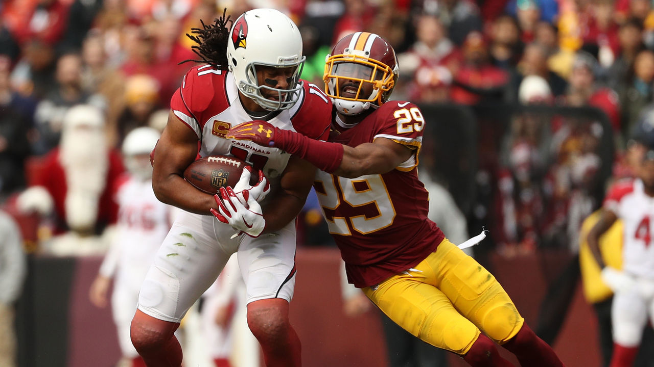 LANDOVER, MD - DECEMBER 17: Wide Receiver Larry Fitzgerald #11 of the Arizona Cardinals is tackled by cornerback Kendall Fuller #29 of the Washington Redskins in the first quarter at FedEx Field on December 17, 2017 in Landover, Maryland.