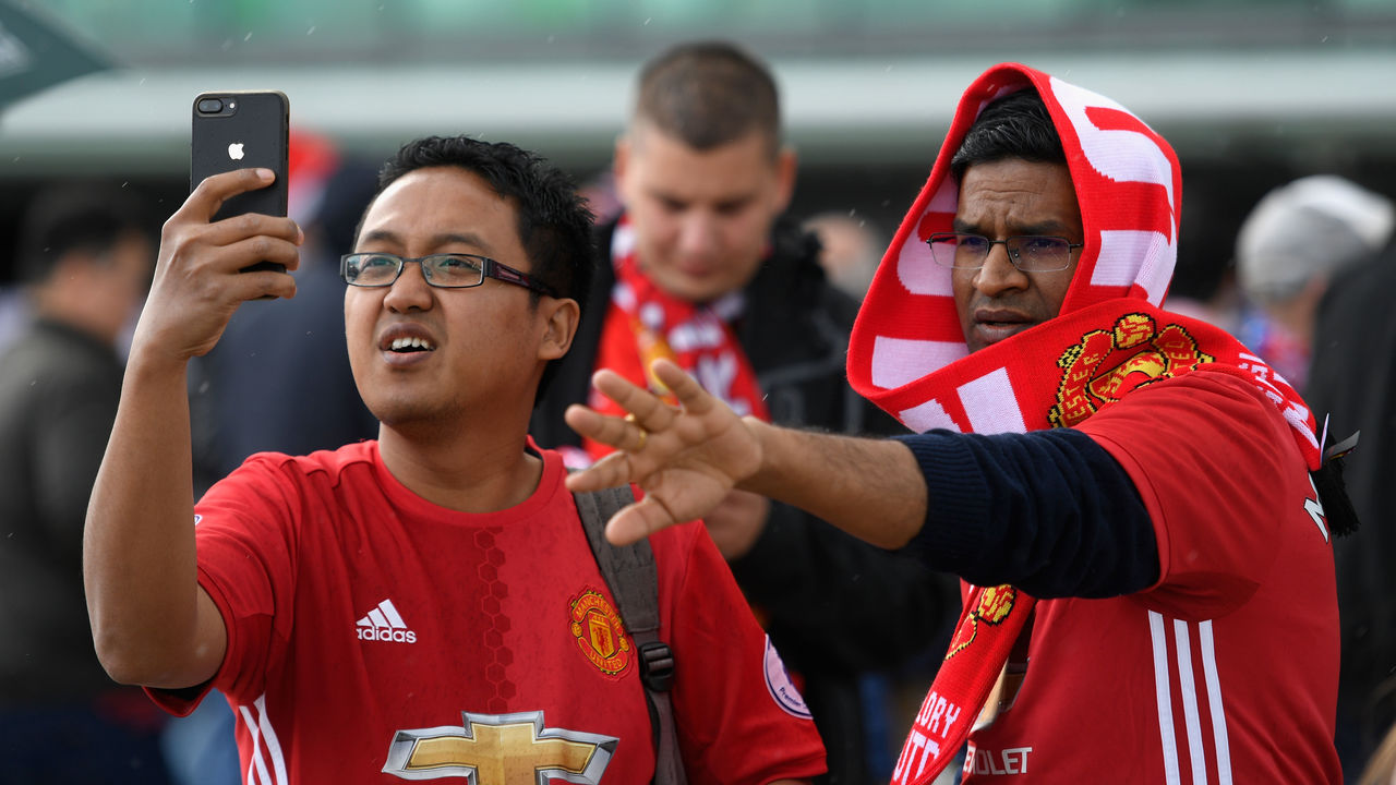 MANCHESTER, ENGLAND - SEPTEMBER 17: Manchester United fans take a selife photograph outside the stadium prior to the Premier League match between Manchester United and Everton at Old Trafford on September 17, 2017 in Manchester, England.