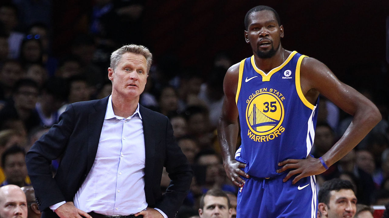SHENZHEN, CHINA - OCTOBER 05: Head coach Steve Kerr of the Golden State Warriors speaks to Kevin Durant #35 during the game between the Minnesota Timberwolves and the Golden State Warriors as part of 2017 NBA Global Games China at Universidade Center on October 5, 2017 in Shenzhen, China.