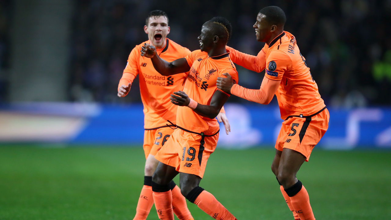 PORTO, PORTUGAL - FEBRUARY 14: Sadio Mane of Liverpool celebrates scoring the first goal with Georginio Wijnaldum and Andy Robertson during the UEFA Champions League Round of 16 First Leg match between FC Porto and Liverpool at Estadio do Dragao on February 14, 2018 in Porto, Portugal.
