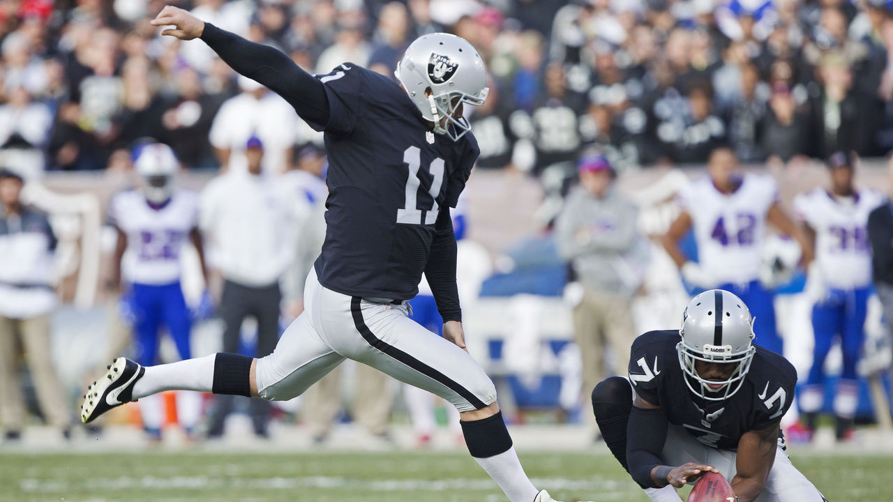 OAKLAND, CA - DECEMBER 4: Kicker Sebastian Janikowski #11 of the Oakland Raiders scores a point after touchdown against the Buffalo Bills on December 4, 2016 at Oakland-Alameda County Coliseum in Oakland, California. The Raiders won 38-24.
