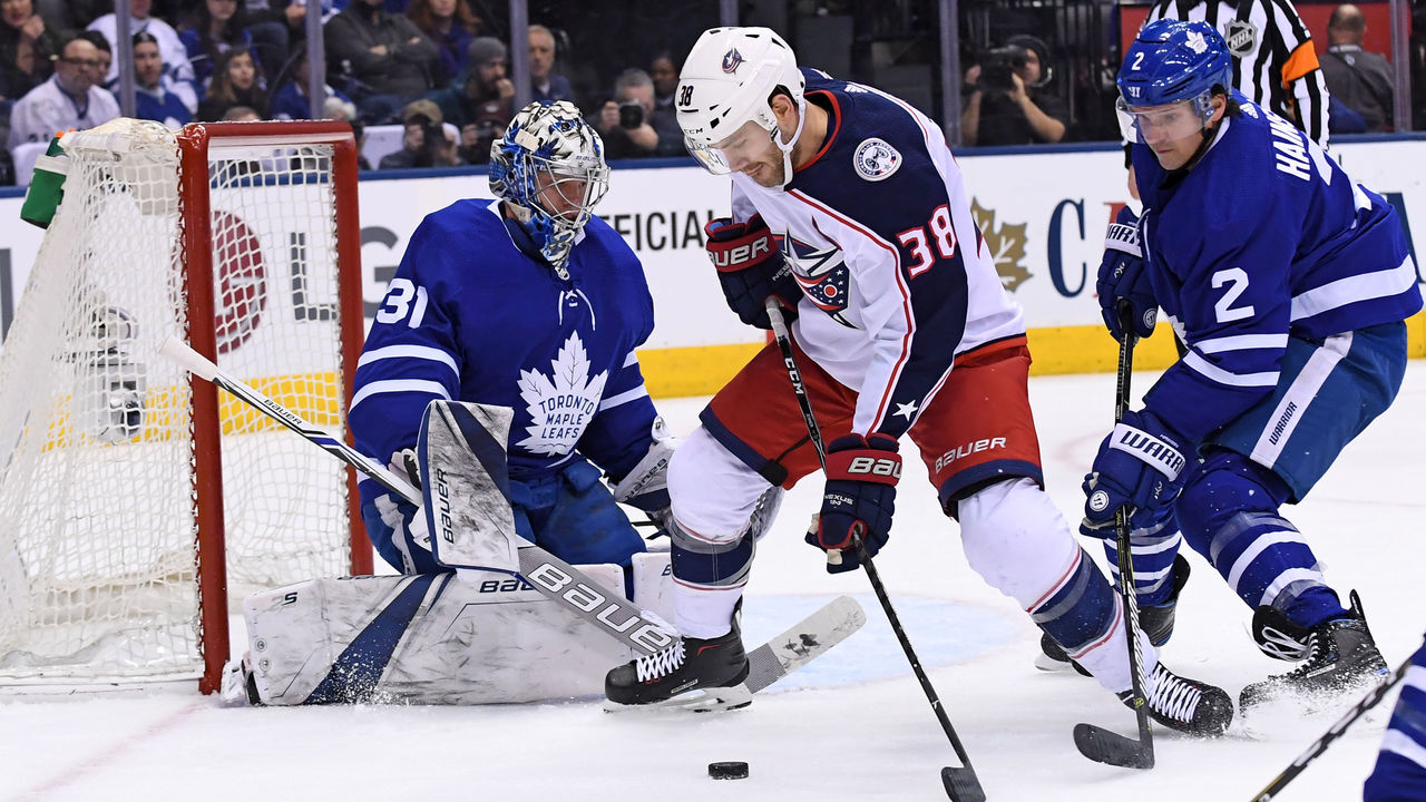 TORONTO, ON - JANUARY 08: Columbus Blue Jackets Center Boone Jenner (38) controls the puck in front of Toronto Maple Leafs Goalie Frederik Andersen (31) and Defenceman Ron Hainsey (2)during the regular season NHL game between the Columbus Blue Jackets and Toronto Maple Leafs on January 8, 2018 at Air Canada Centre in Toronto, ON.