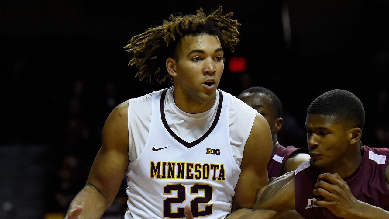 MINNEAPOLIS, MN - NOVEMBER 21: Evan Wiley #24 of the Alabama A&M Bulldogs knocks the ball away from Reggie Lynch #22 of the Minnesota Golden Gophers during the second half of the game on November 21, 2017 at Williams Arena in Minneapolis, Minnesota. The Golden Gophers defeated the Bulldogs 100-57.