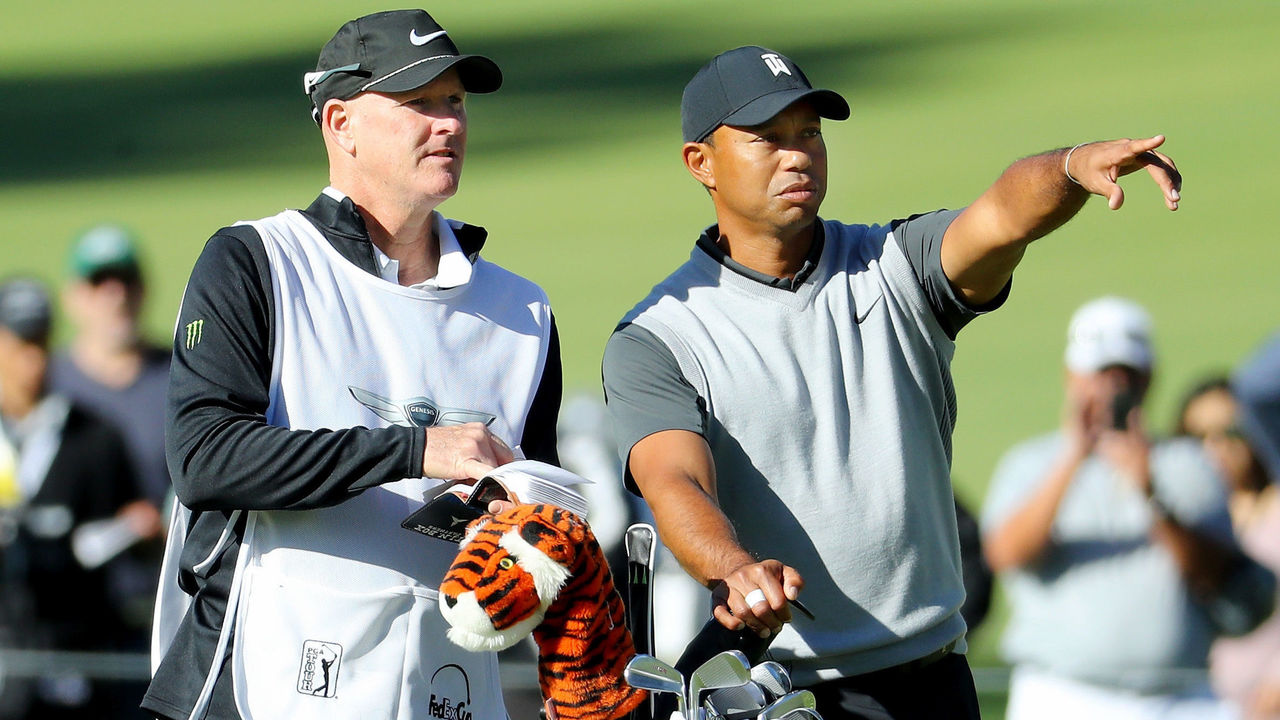 PACIFIC PALISADES, CA - FEBRUARY 15: Tiger Woods and caddie Joe LaCava line up a shot on the 17th hole during the first round of the Genesis Open at Riviera Country Club on February 15, 2018 in Pacific Palisades, California.
