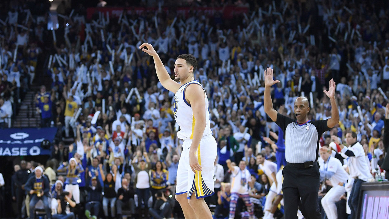 OAKLAND, CA - DECEMBER 25: Klay Thompson #11 of the Golden State Warriors reacts after making a three-point shot against the Cleveland Cavaliers during an NBA basketball game at ORACLE Arena on December 25, 2017 in Oakland, California.
