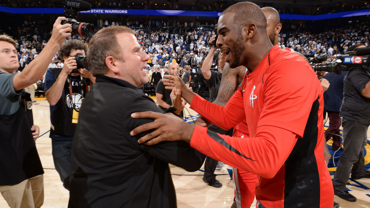 OAKLAND, CA - OCTOBER 17: Houston Rockets owner, Tilman Fertitta greets Chris Paul #3 of the Houston Rockets after winning the game against the Golden State Warriors on October 17, 2017 at ORACLE Arena in Oakland, California. NOTE TO USER: User expressly acknowledges and agrees that, by downloading and or using this photograph, user is consenting to the terms and conditions of Getty Images License Agreement. Mandatory Copyright Notice: Copyright 2017 NBAE