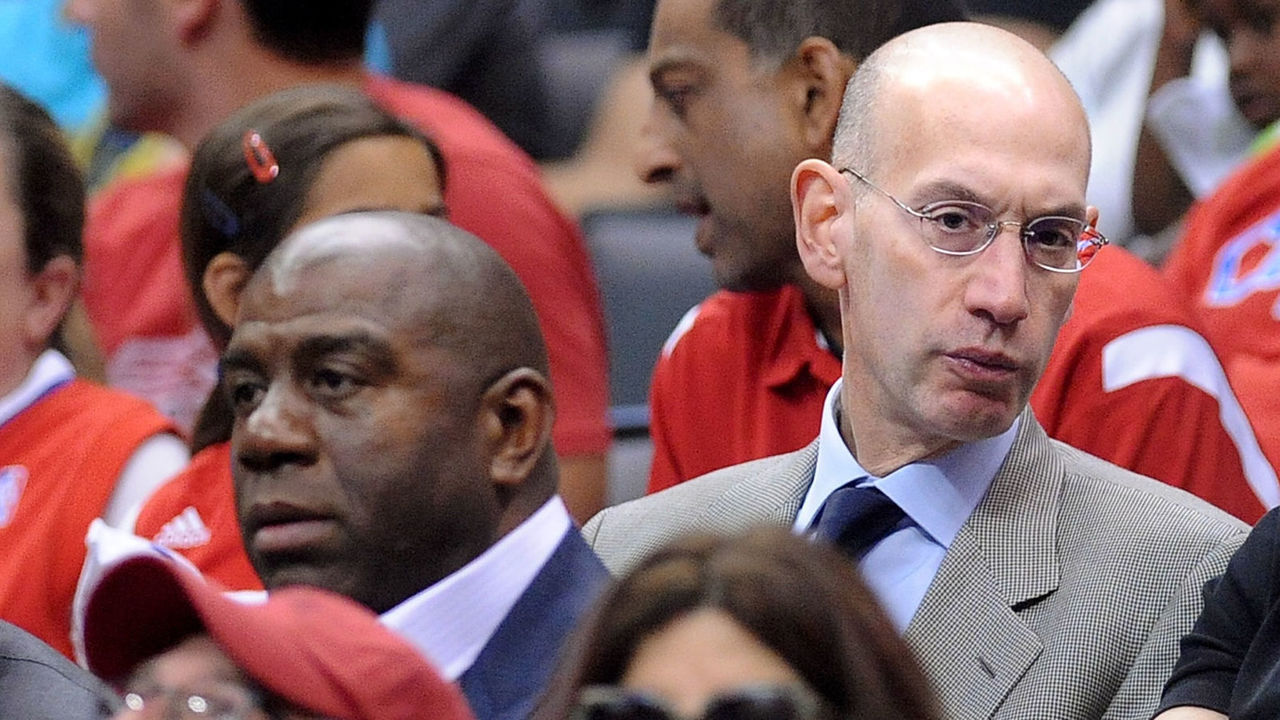 LOS ANGELES, CALIFORNIA MAY 11, 2014-NBA Comissioner Adam Silver, center, sits next to Magic Johnson, left, during the Clippers/ Thunder game Sunday at the Staples Center Sunday.