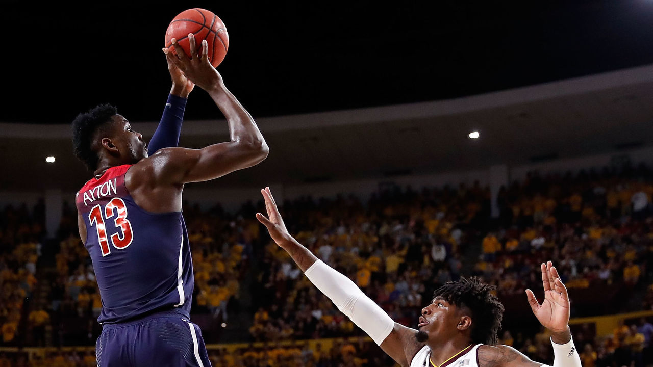 TEMPE, AZ - FEBRUARY 15: Deandre Ayton #13 of the Arizona Wildcats shoots over Romello White #23 of the Arizona State Sun Devils during the first half of the college basketball game at Wells Fargo Arena on February 15, 2018 in Tempe, Arizona.