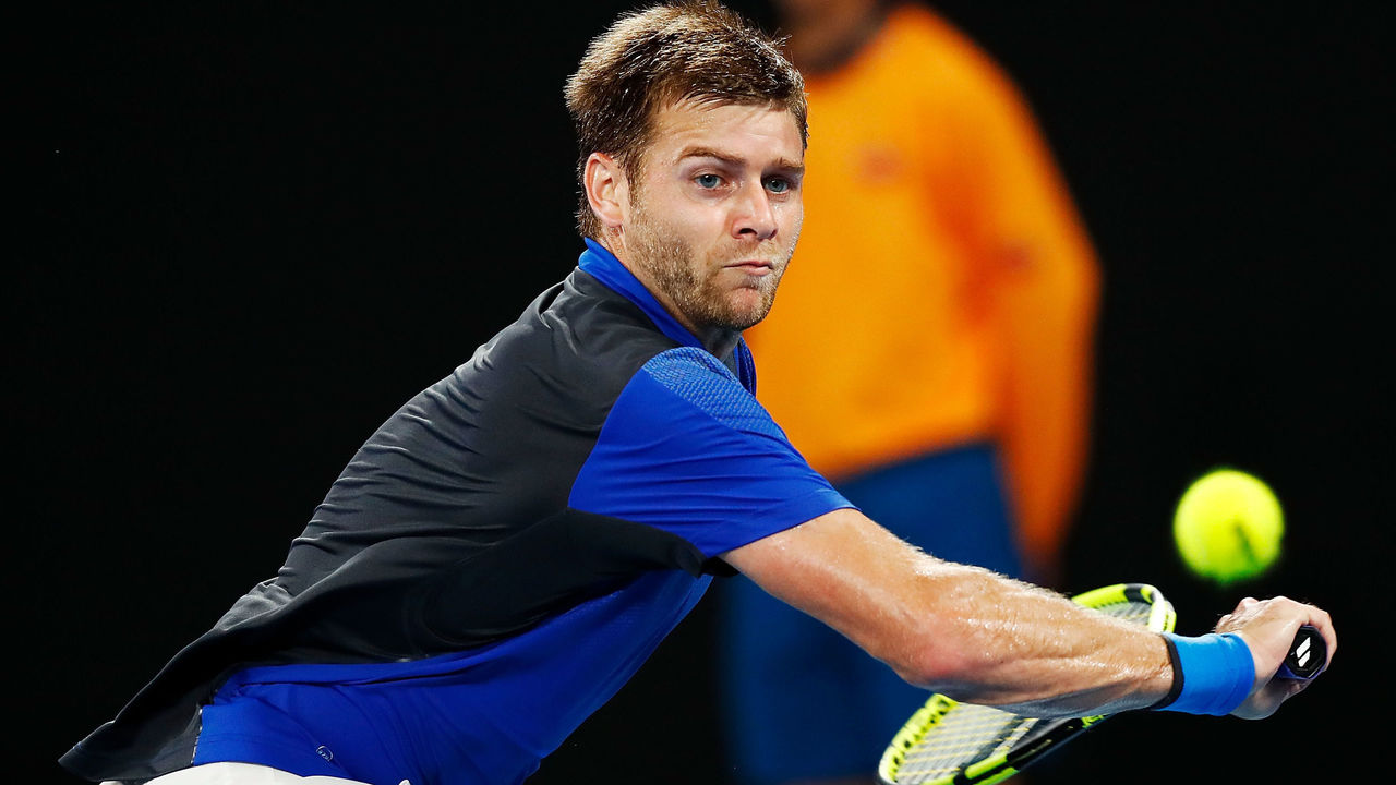MELBOURNE, AUSTRALIA - JANUARY 19: Ryan Harrison of the USA plays a backhand in his third round match against Marin Cilic of Croatia on day five of the 2018 Australian Open at Melbourne Park on January 19, 2018 in Melbourne, Australia.
