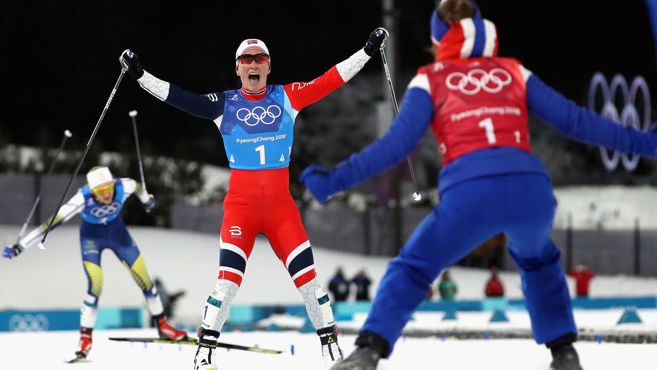 PYEONGCHANG-GUN, SOUTH KOREA - FEBRUARY 17: Marit Bjoergen of Norway (1-4) celebrates as she crosses the finish line to win gold with Ingvild Flugstad Oestberg of Norway (1-1) during the Ladies' 4x5km Relay on day eight of the PyeongChang 2018 Winter Olympic Games at Alpensia Cross-Country Centre on February 17, 2018 in Pyeongchang-gun, South Korea.