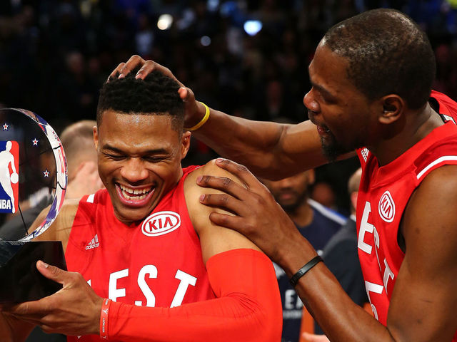 TORONTO, ON - FEBRUARY 14: MVP Russell Westbrook #0 of the Oklahoma City Thunder and the Western Conference is congratulated by teammate Kevin Durant #35 after defeating the Eastern Conference during the NBA All-Star Game 2016 at the Air Canada Centre on February 14, 2016 in Toronto, Ontario. NOTE TO USER: User expressly acknowledges and agrees that, by downloading and/or using this Photograph, user is consenting to the terms and conditions of the Getty Images License Agreement.