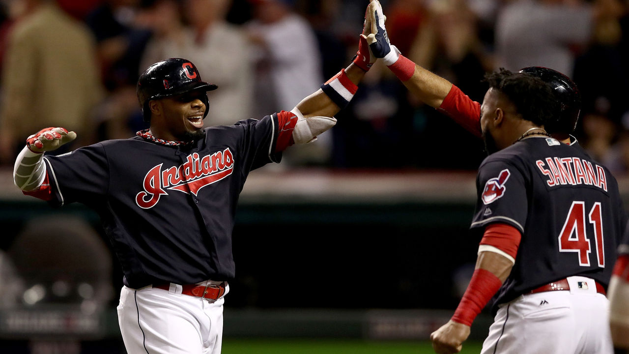 CLEVELAND, OH - NOVEMBER 02: Rajai Davis #20 of the Cleveland Indians celebrates with teammates after hitting a two-run home run during the eighth inning to tie the game 6-6 against the Chicago Cubs in Game Seven of the 2016 World Series at Progressive Field on November 2, 2016 in Cleveland, Ohio.