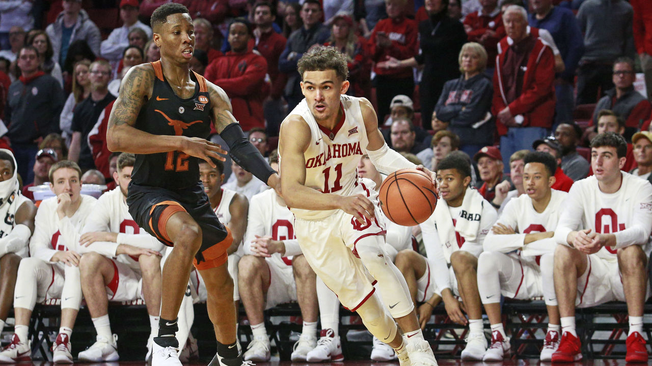 NORMAN, OK - FEBRUARY 17: Trae Young #11 of the Oklahoma Sooners drives the baseline on Kerwin Roach II #12 of the Texas Longhorns at Lloyd Noble Center on February 17, 2018 in Norman, Oklahoma. The Longhorns defeated the Sooners 77-66.