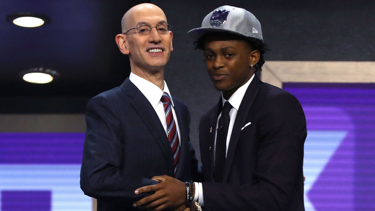 NEW YORK, NY - JUNE 22: De'Aaron Fox walks on stage with NBA commissioner Adam Silver after being drafted fifth overall by the Sacramento Kings during the first round of the 2017 NBA Draft at Barclays Center on June 22, 2017 in New York City.
