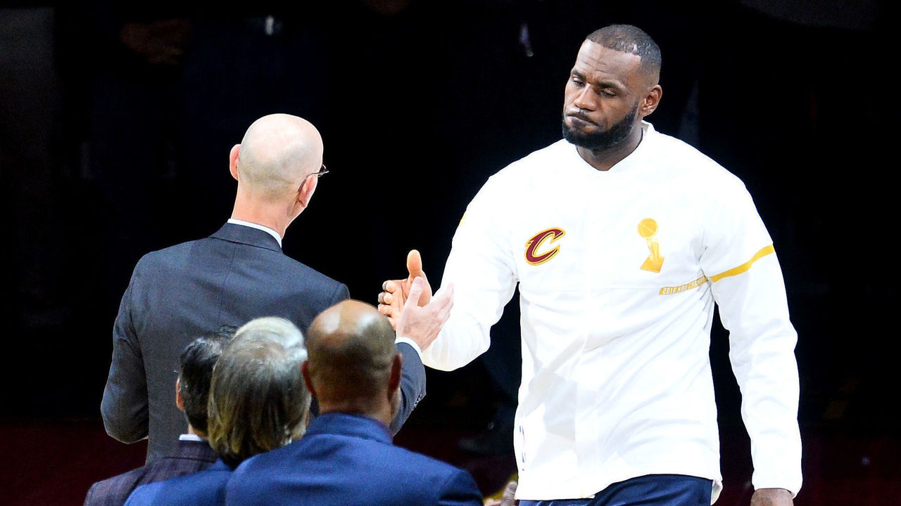 CLEVELAND, OH - OCTOBER 25: LeBron James #23 of the Cleveland Cavaliers receives his championship ring from NBA commissioner Adam Silver before the game against the New York Knicks at Quicken Loans Arena on October 25, 2016 in Cleveland, Ohio.