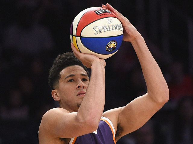 LOS ANGELES, CA - FEBRUARY 17: Devin Booker #1 of the Phoenix Suns competes in the 2018 Taco Bell Skills Challenge at Staples Center on February 17, 2018 in Los Angeles, California.