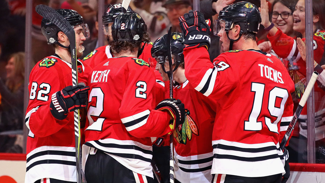 CHICAGO, IL - FEBRUARY 17: (L-R) Jordan Oesterle #82, Duncan Keith #2, Patrick Kane #88 and Jonathan Toews #19 of the Chicago Blackhawks celebrate a second period goal by Kane against the Washington Capitals at the United Center on February 17, 2018 in Chicago, Illinois.