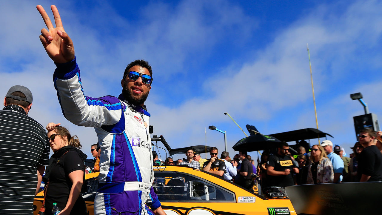 DAYTONA BEACH, FL - FEBRUARY 18: Darrell Wallace Jr., driver of the #43 Click n' Close Chevrolet, stands on the grid prior to the Monster Energy NASCAR Cup Series 60th Annual Daytona 500 at Daytona International Speedway on February 18, 2018 in Daytona Beach, Florida.