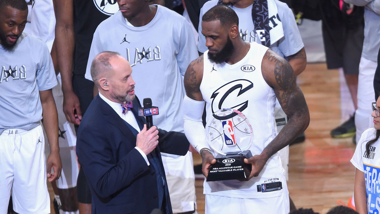 LOS ANGELES, CA - FEBRUARY 18: LeBron James #23 accepts the MVP award from TNT sportscaster Ernie Johnson Jr. during the NBA All-Star Game 2018 at Staples Center on February 18, 2018 in Los Angeles, California.