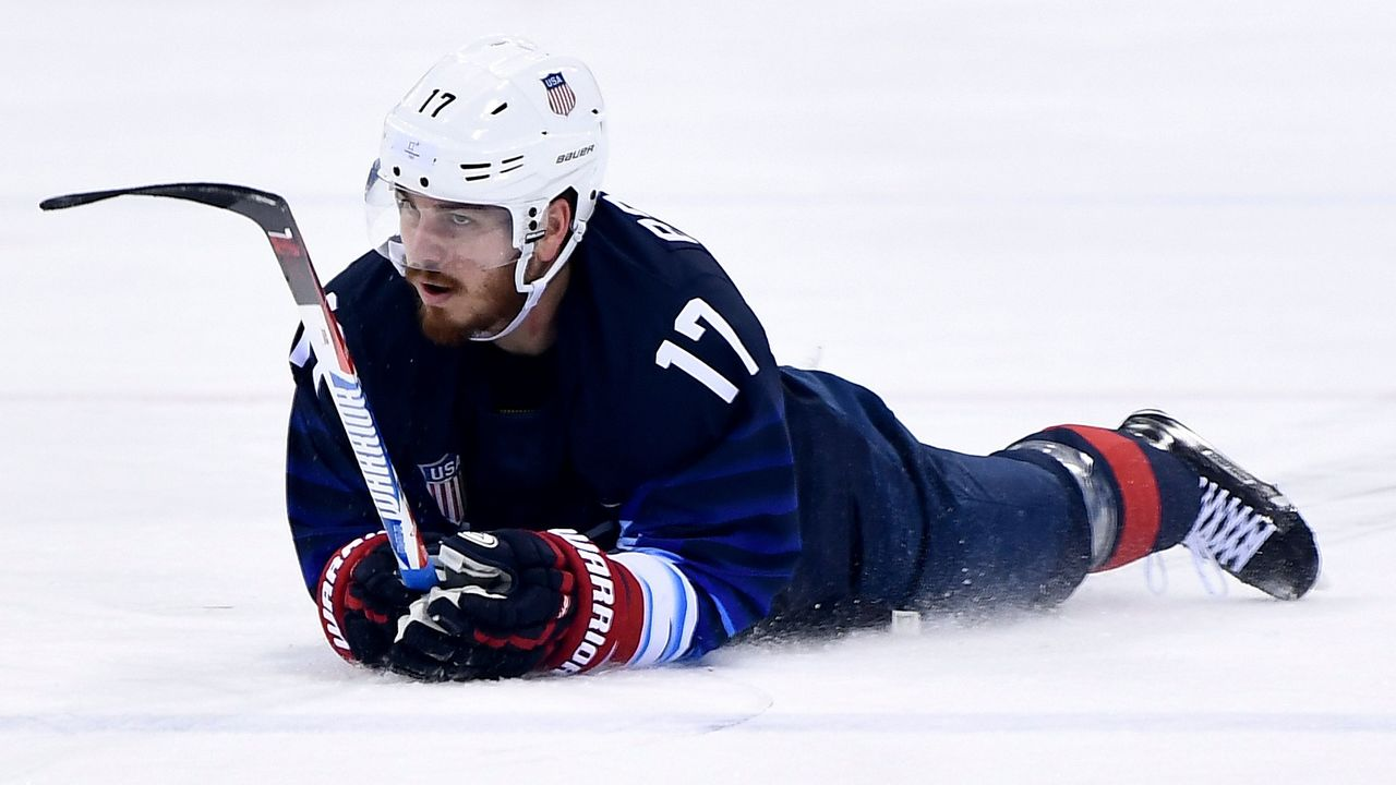 USA's Chris Bourque lies on the ice in the men's preliminary round ice hockey match between the US and Slovakia during the Pyeongchang 2018 Winter Olympic Games at the Gangneung Hockey Centre in Gangneung on February 16, 2018. / AFP PHOTO / Brendan Smialowski
