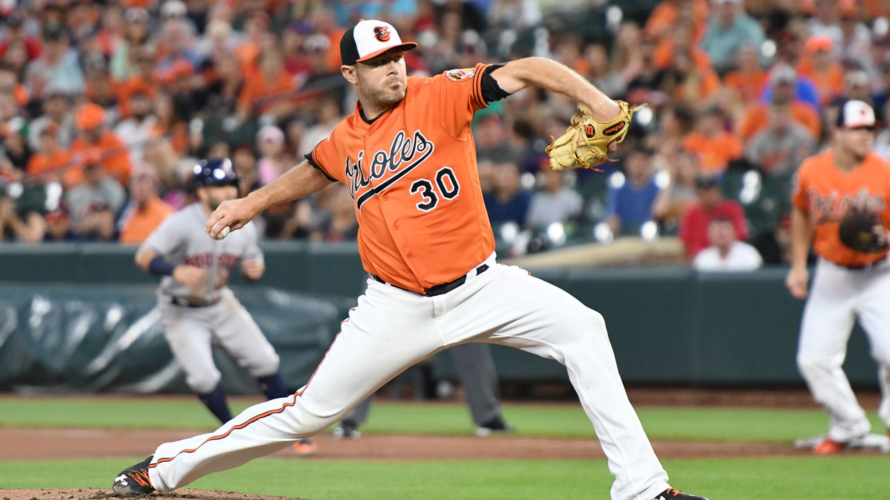 BALTIMORE, MD - JULY 22: Chris Tillman #30 of the Baltimore Orioles pitches in the first inning during a baseball game against the Houston Astros at Oriole Park at Camden Yards on July 22, 2017 in Baltimore, Maryland.