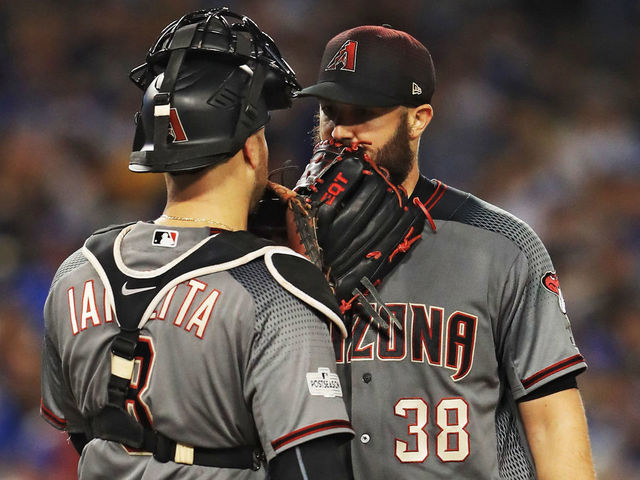 LOS ANGELES, CA - OCTOBER 07: Chris Iannetta #8 visits Robbie Ray #38 of the Arizona Diamondbacks on the mound against the Los Angeles Dodgers in game two of the National League Division Series at Dodger Stadium on October 7, 2017 in Los Angeles, California.