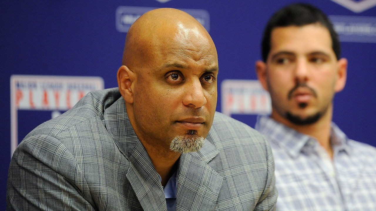 NEW YORK, NY - NOVEMBER 22: Tony Clark (L) and Carlos Villanueva listen as Major League Baseball Commissioner Bud Selig speaks at a news conference at MLB headquarters on November 22, 2011 in New York City. Selig announced a new five-year labor agreement between Major League Baseball and the Major League Baseball Players Association.