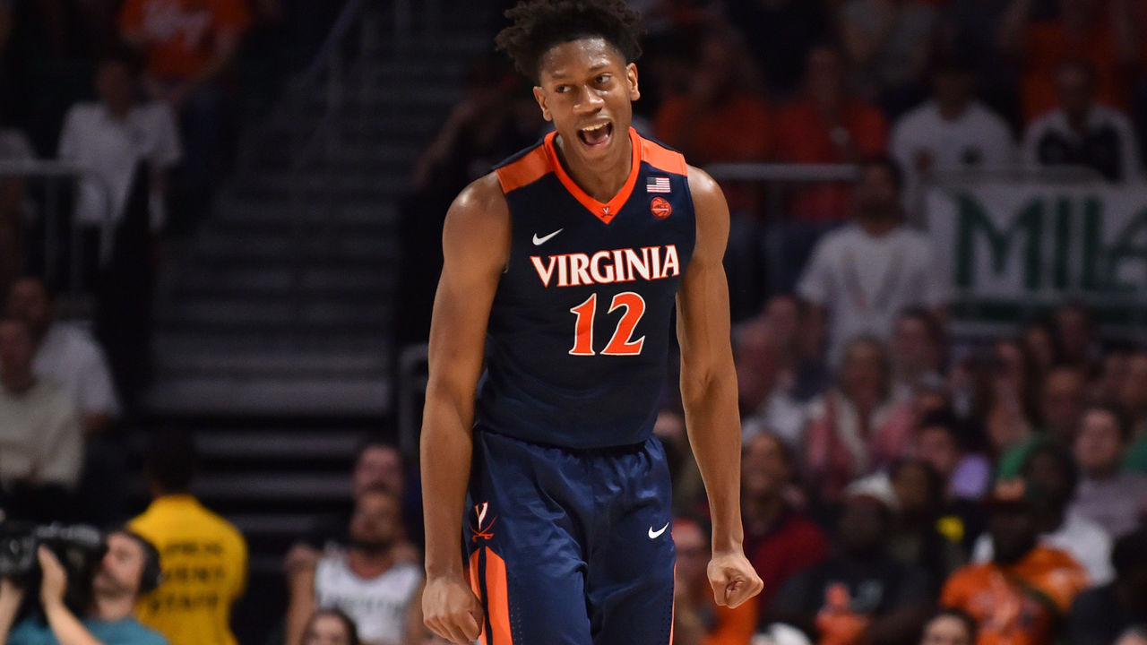 MIAMI, FL - FEBRUARY 13: De'Andre Hunter #12 of the Virginia Cavaliers reacts after hitting a three pointer in the second half of the game against the Miami Hurricanes at The Watsco Center on February 13, 2018 in Miami, Florida.