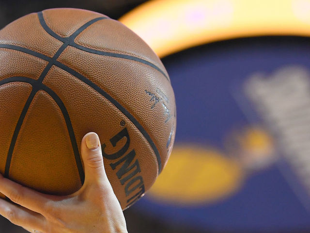OAKLAND, CA - FEBRUARY 06: A detailed view ot the official Spalding NBA basketball held in the air by referee Lauren Holtkamp #7 during an NBA basketball game between the Oklahoma City Thunder and Golden State Warriors at ORACLE Arena on February 6, 2018 in Oakland, California.