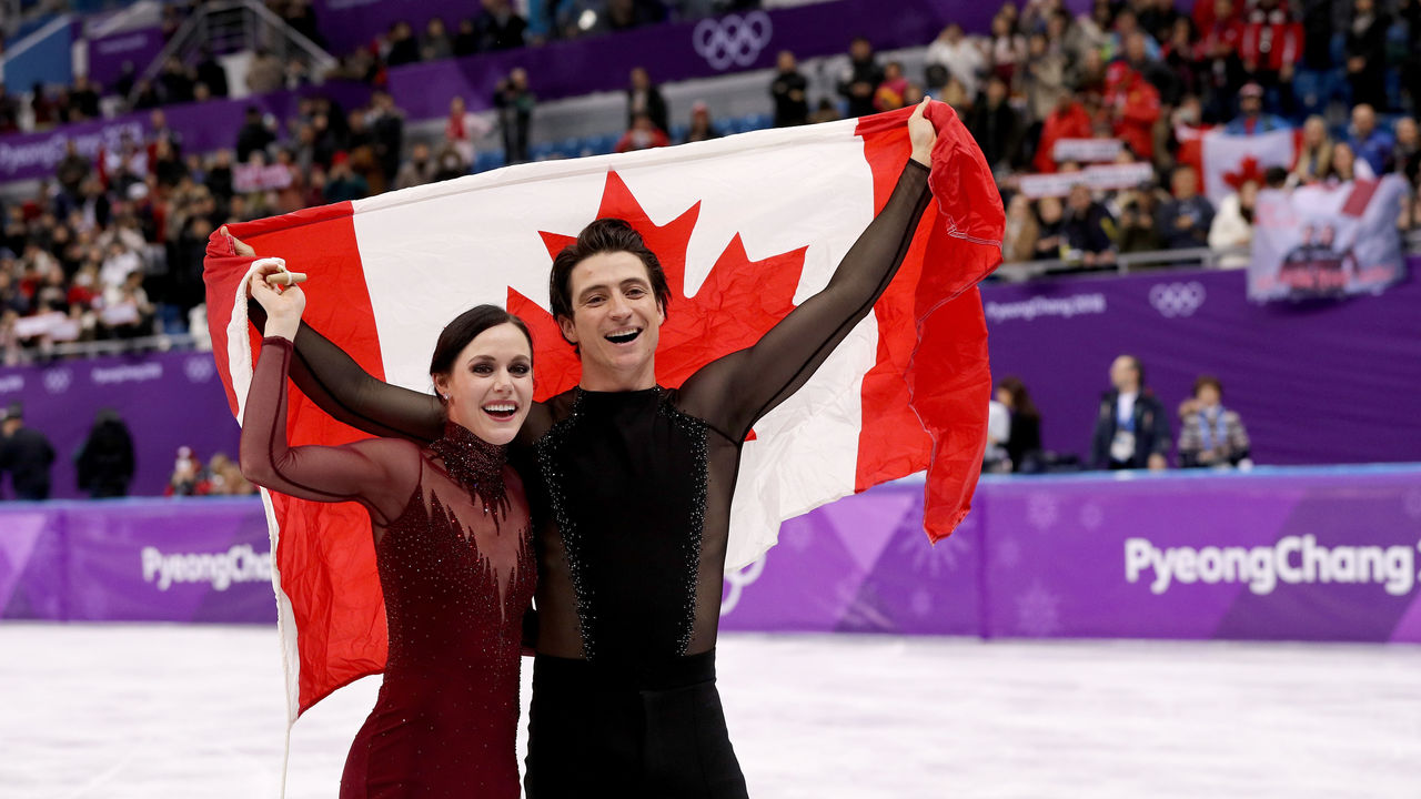 GANGNEUNG, SOUTH KOREA - FEBRUARY 20: Gold medal winners Tessa Virtue and Scott Moir of Canada celebrate during the victory ceremony for the Figure Skating Ice Dance Free Dance on day eleven of the PyeongChang 2018 Winter Olympic Games at Gangneung Ice Arena on February 20, 2018 in Gangneung, South Korea.