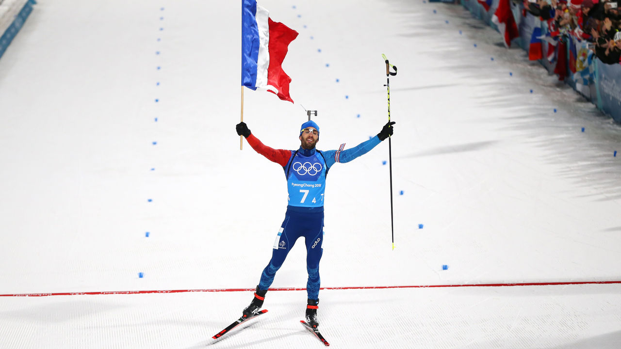 PYEONGCHANG-GUN, SOUTH KOREA - FEBRUARY 20: Martin Fourcade of France celebrates crossing the finish line to win the gold medal during the Biathlon 2x6km Women + 2x7.5km Men Mixed Relay on day 11 of the PyeongChang 2018 Winter Olympic Games at Alpensia Biathlon Centre on February 20, 2018 in Pyeongchang-gun, South Korea.